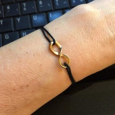 Cord bracelet gold plated infinity