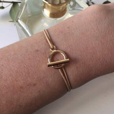 Child gold plated small toggle cord bracelet