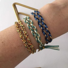 Chain bracelet gold plated two colored braided chain and cords rows