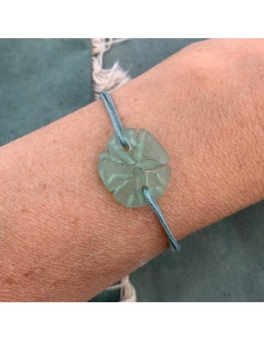 Aqua green sand dollar with cord...