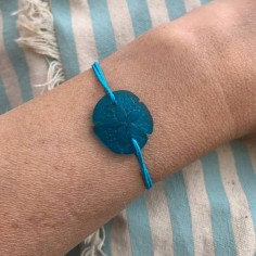 Turquoise sand dollar with...