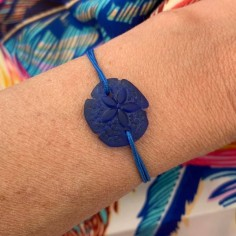 Blue sand dollar with cord...