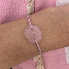 Pink sand dollar with cord...