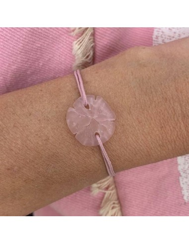 Pink sand dollar with cord bracelet