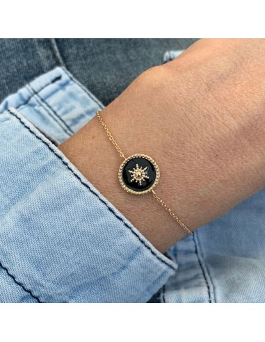 Gold plated black medal with star...