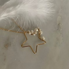 Gold plated star with white...